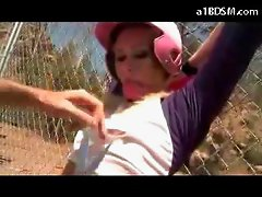 Blonde Girl In Baseball Dress Tied To Fence Getting Her Pussy Fucked With Toy