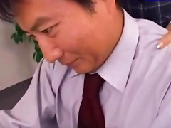 Office Lady Sitting To Her Colleague Jerking His Cock Other Girl Joining Them In The Office