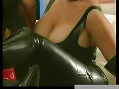 Kinky lesbians in boots using sex toys