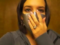 Abby shows us her love for breath play by demonstrating perfectly how to seal up the nose and mouth with duct tape Doesnt she do a good job