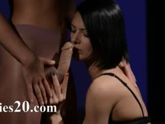 Horny brunette eating penis of rubber