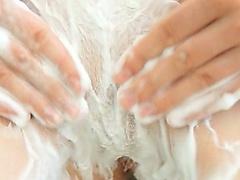 Shaving her amazingly skinny hole