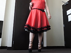 Sissy Ray in Red Taffeta Dress in hotel room