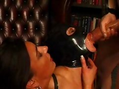 latex masked whore recieves cum from huge cock