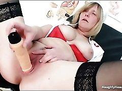 Mature chick in nurse uniform has perky tits