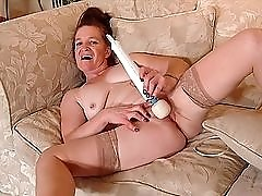Redheaded granny vibrates her clit and plays with her asshole