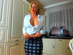 Bodacious blonde mom exposes her curves and toys her pussy