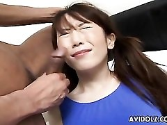 Asian in a sexy blue swimsuit swallows cock