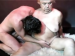 Cock and strapon fill granny pussy in threesome