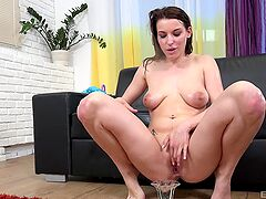 Appealing babe squirts during a massive fuck play on cam