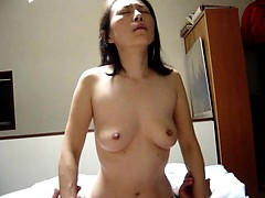 Kinky Oriental lady gets on top of her man and slowly rides