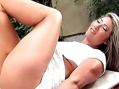 Sexy blonde with tan lines Leticia Sanches masturbates outdoors.