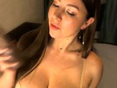 Sleek And Angelic Brunette Slips Off Her Bra And Panties