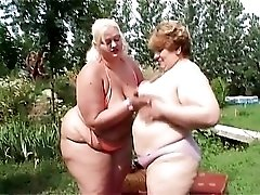 Fondling and tribbing fat lesbians outdoors