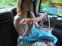 Two kinky babes fuck dildo in taxi
