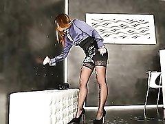 Pretty business girl takes cum from a gloryhole dildo