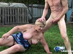 Granny enjoys a cumshot after passionate outdoor fucking