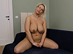 Blonde Milf in glasses strips and reveals her amazing naturals
