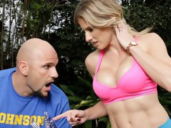 Fake-boobed chick Cory Chase impaled in the doggy style pose