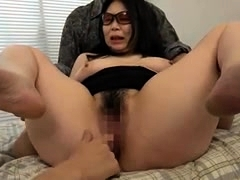 Big breasted Japanese milf has two guys satisfying her needs