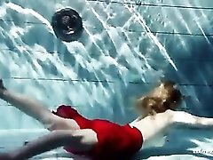 Blonde swims and loses all her clothing