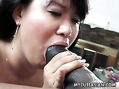 Voluptuous Asian gives head to huge black cock