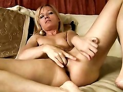 Eager solo blonde milf shoves toys in her pussy and ass
