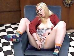 Cute Blonde Teen Masturbates in a Chair