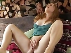 Beautiful redhead retro girl reads vintage sex book and strokes pussy