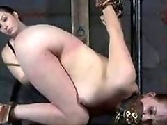 Redhead bitch gets whipped while having bondage sex BDSM movie